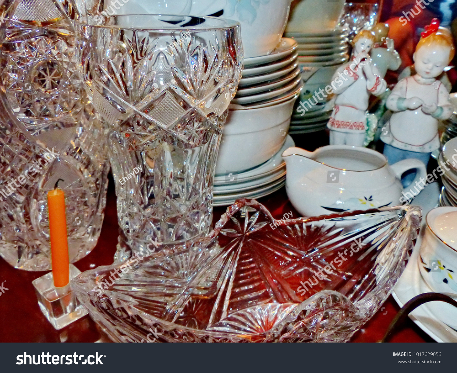 Crystal vases and home tableware in traditional style. Figures from Russian porcelain. Crystal glass & Crystal Vases Home Tableware Traditional Style Stock Photo ...