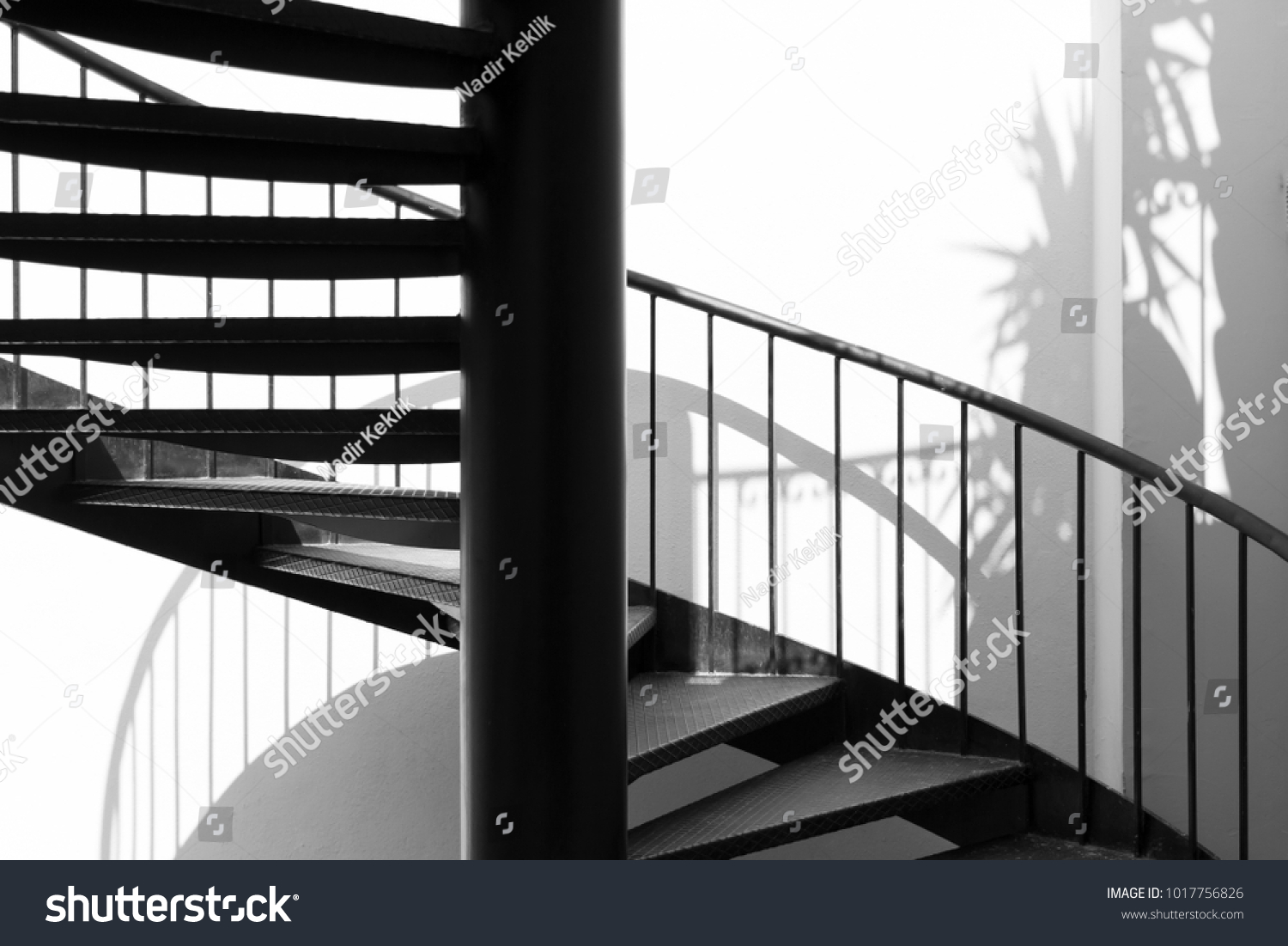 Black Metal Round Stair With White Wall And Shadows. Stairway, Staircase,  Stairwell,