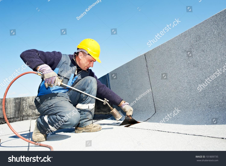 Roofer Installing Roofing Felt Heating Melting Stock Photo