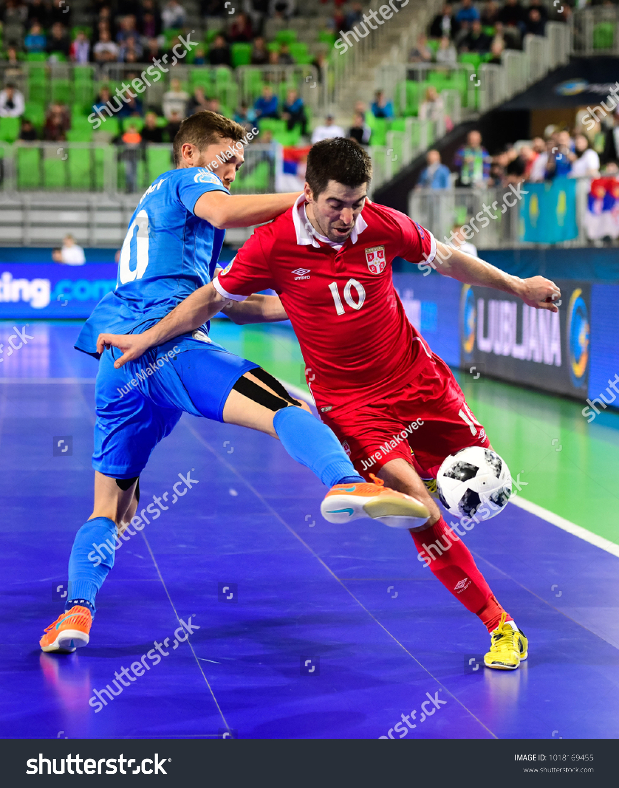ab417da800fac Chingiz Yesenamanov (L) of Kazakhstan vies with Mladen Kocic of Serbia  during Serbia vs. Kazakhstan UEFA European Futsal Championship 2018 match  at Arena ...