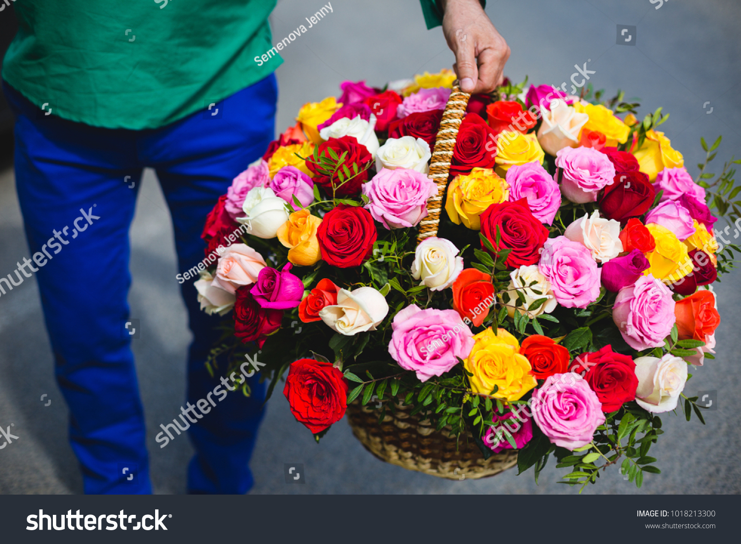 Flower Delivery Man Holding Large Basket Stock Photo Edit Now