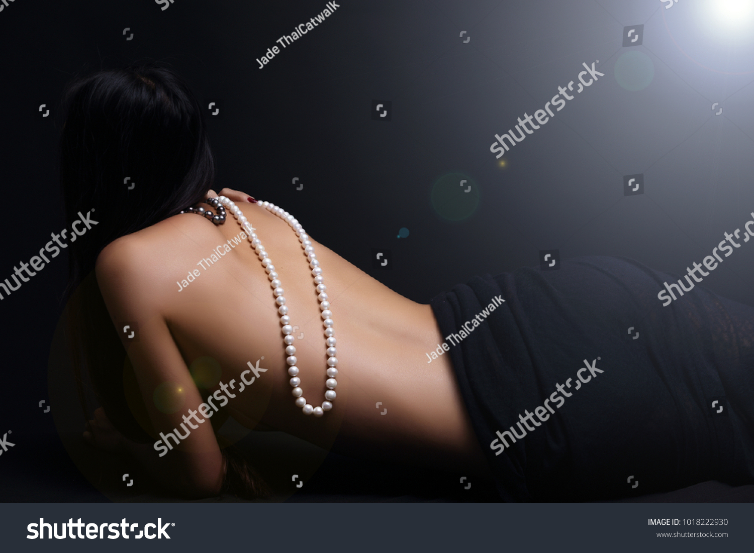 Nude girls with cross necklace apologise, but