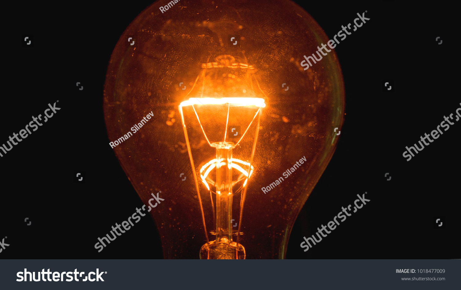 Light bulb on a black background #1018477009