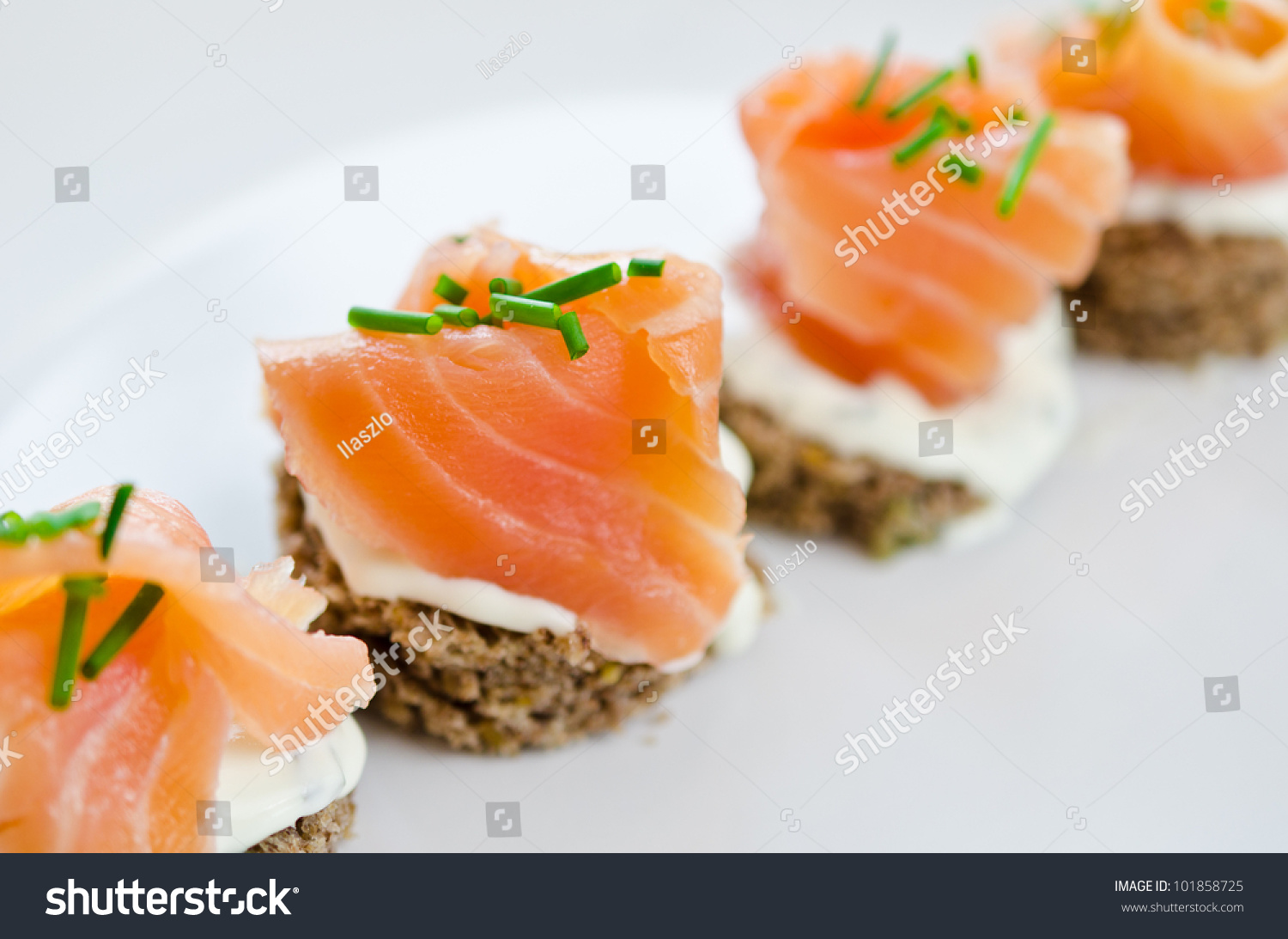 Canapes with smoked salmon and cream cheese stock photo for Smoked salmon cream cheese canape