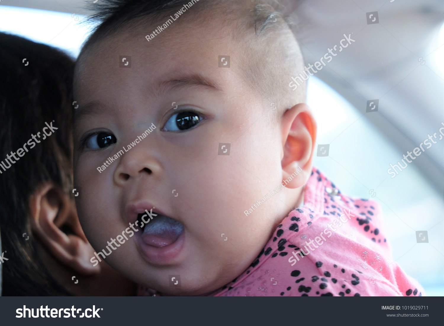 cute baby girl smiling happily her stock photo (safe to use