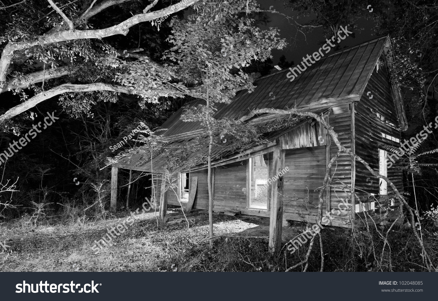 Exterior Of An Old Abandoned House At Night Stock Photo ...