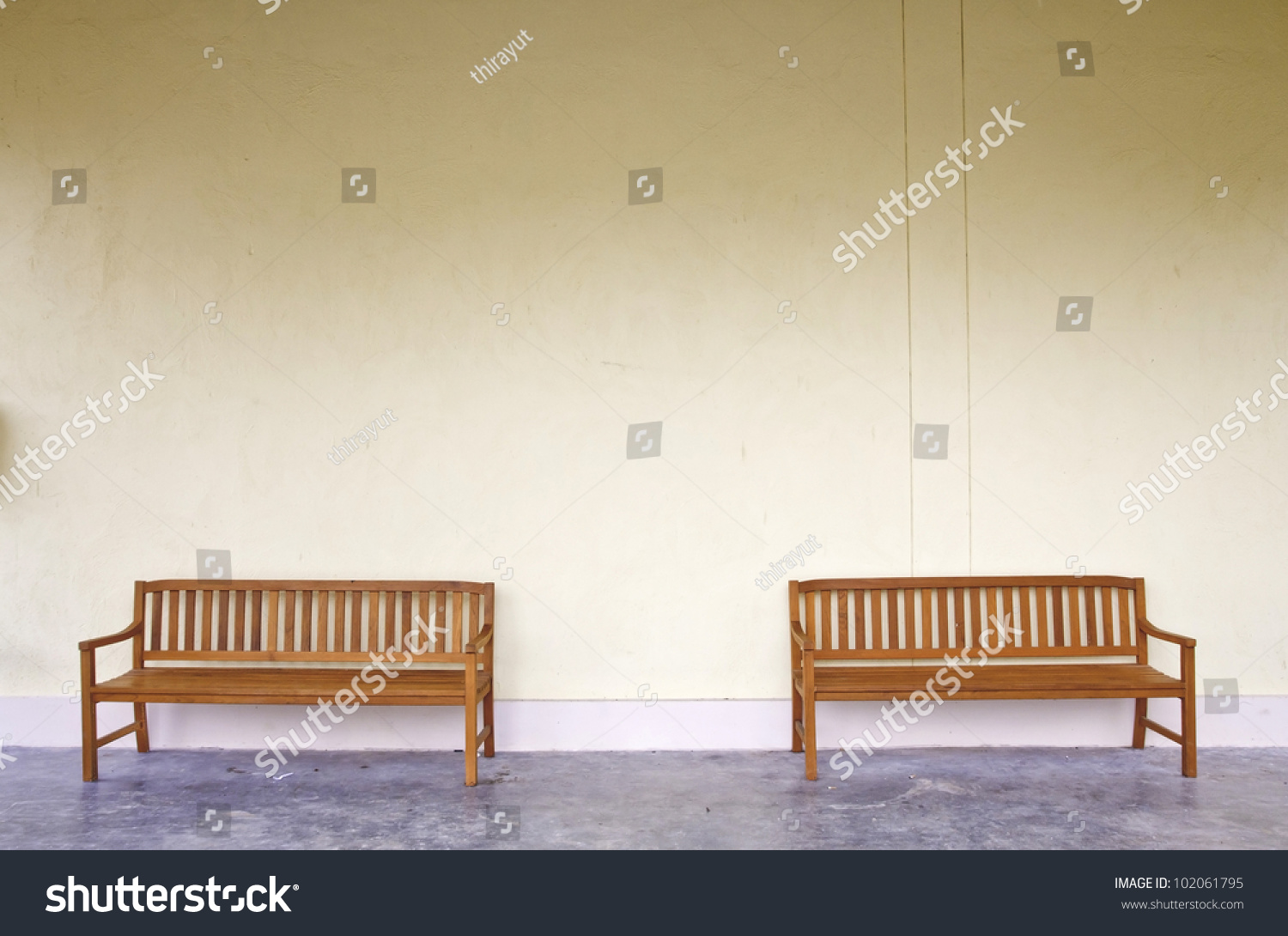 Unique Wood Bench Against Blank Wall And Green Trash Stock