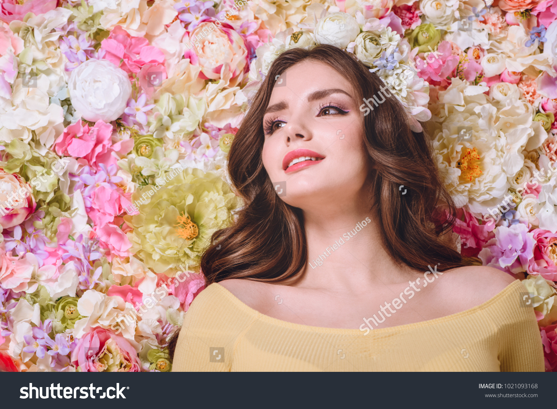 Beautiful girl with flowers wreath on head looking away ez canvas id 1021093168 izmirmasajfo