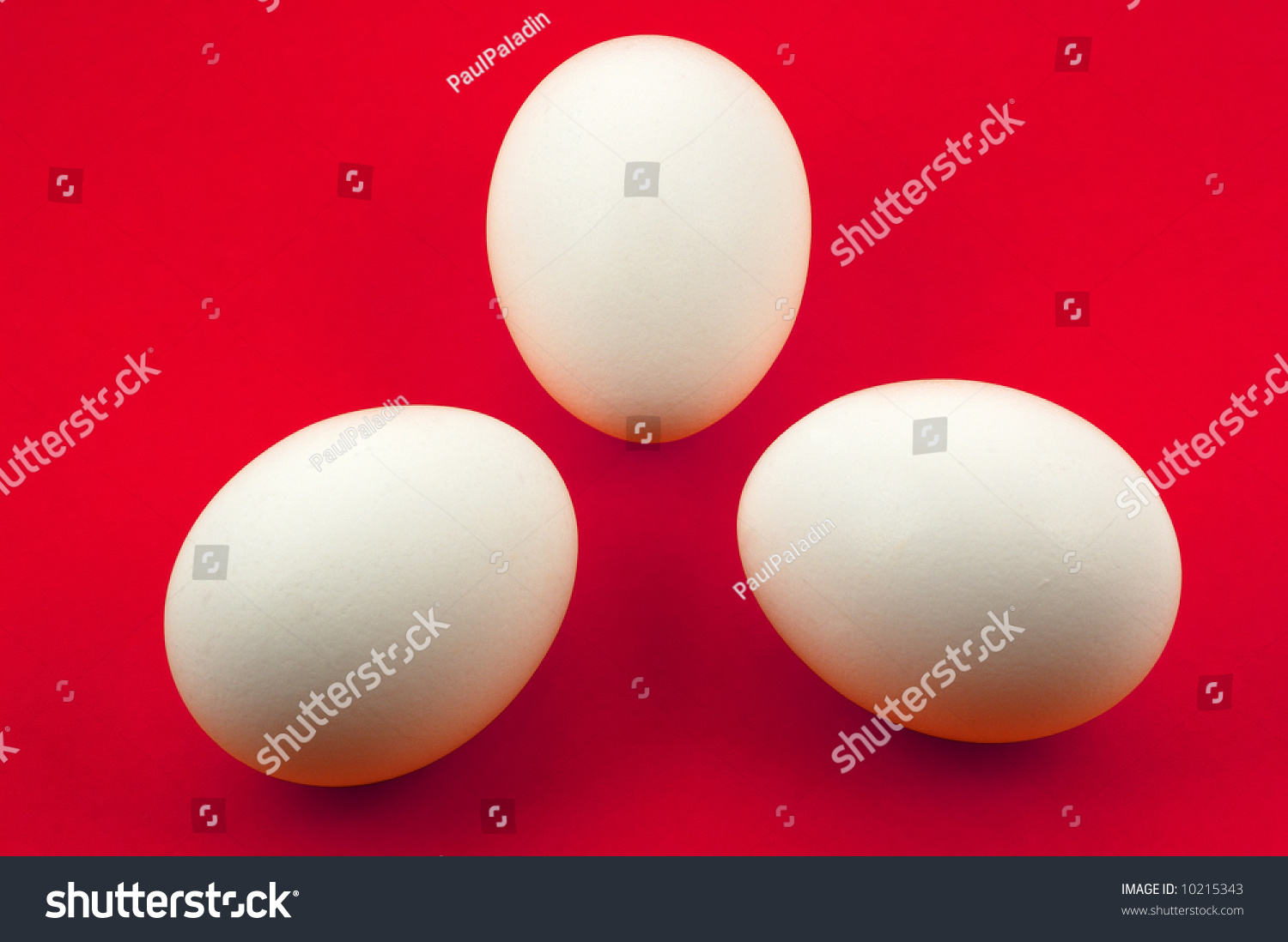 tree white eggs on red background clipping path for easy