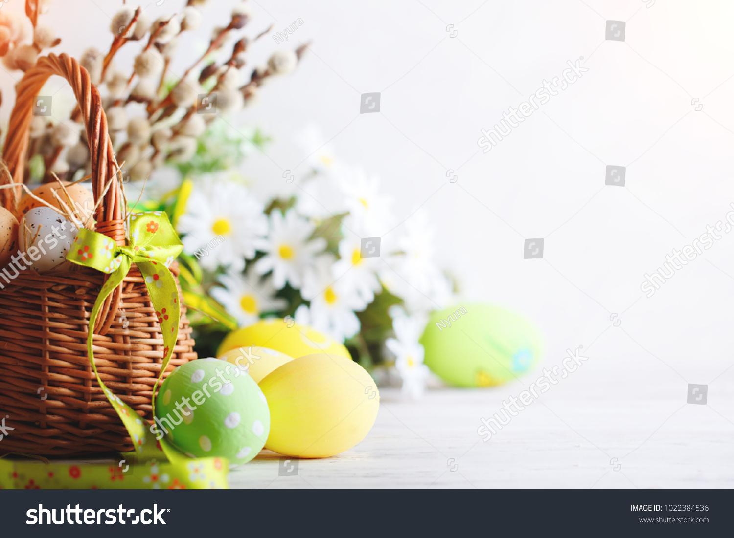 Happy Easter. Congratulatory easter background. Easter eggs and flowers. #1022384536 - 123PhotoFree.com