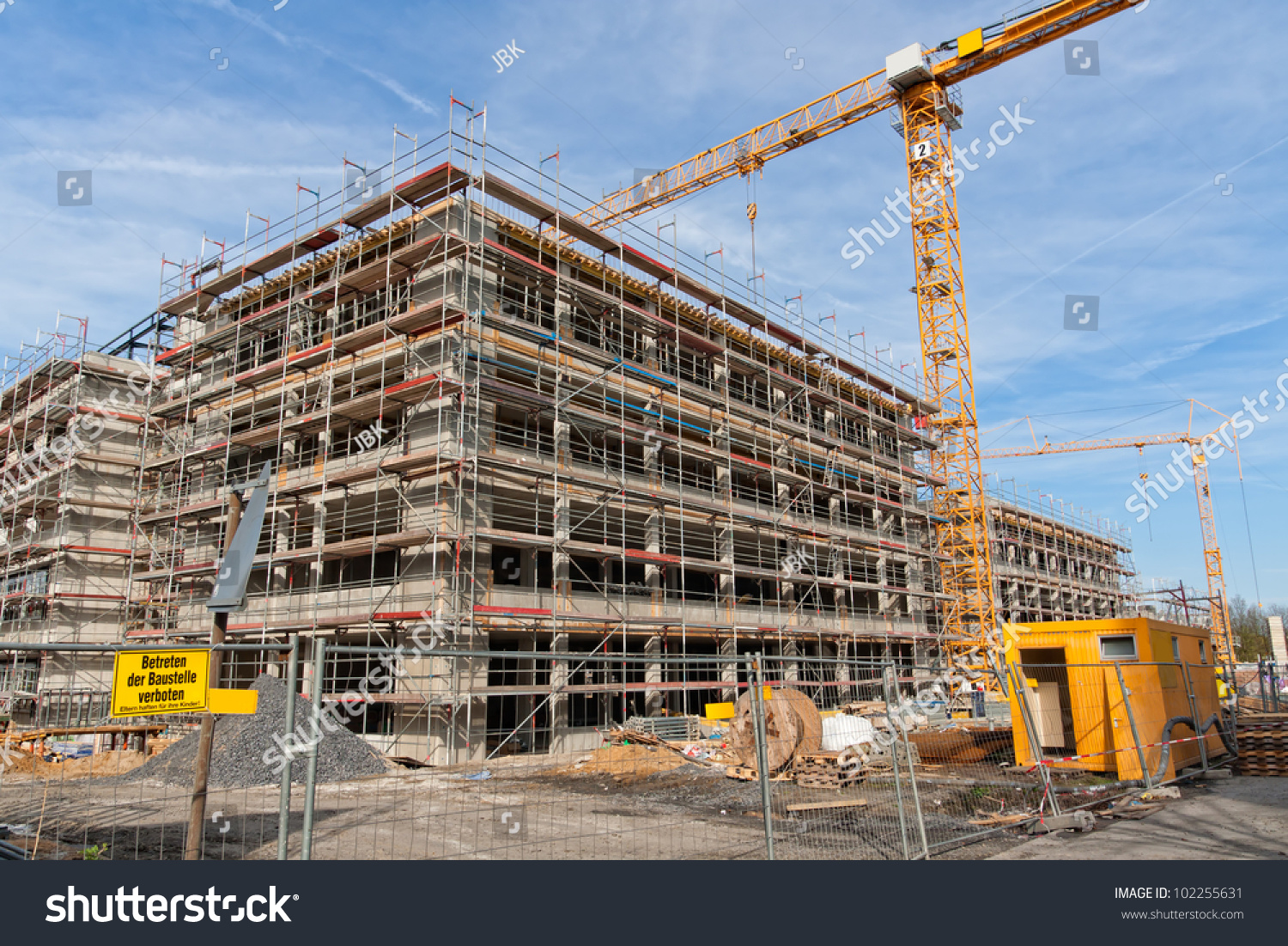 Large construction site scaffolding building yellow stock - Exterior scaffolding rental near me ...