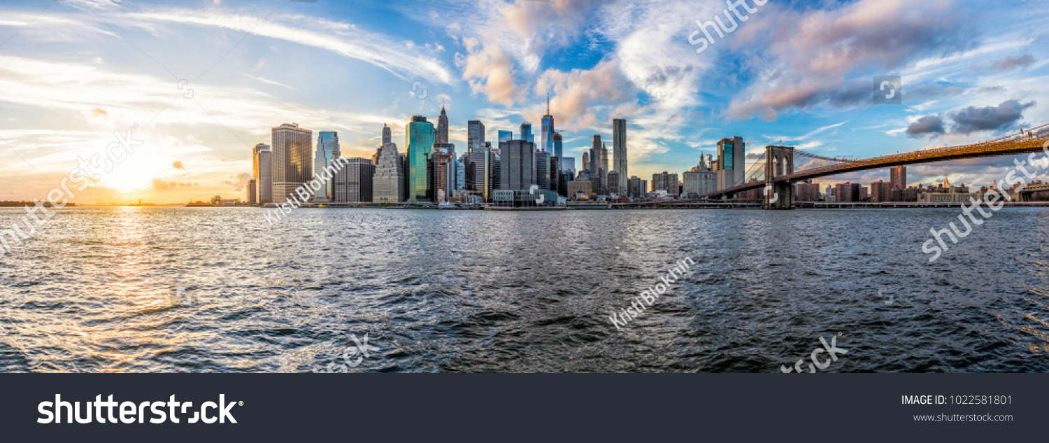 Panoramic Panorama view of outside outdoors in NYC New York City Brooklyn Bridge Park by east river, cityscape skyline during sunset #1022581801