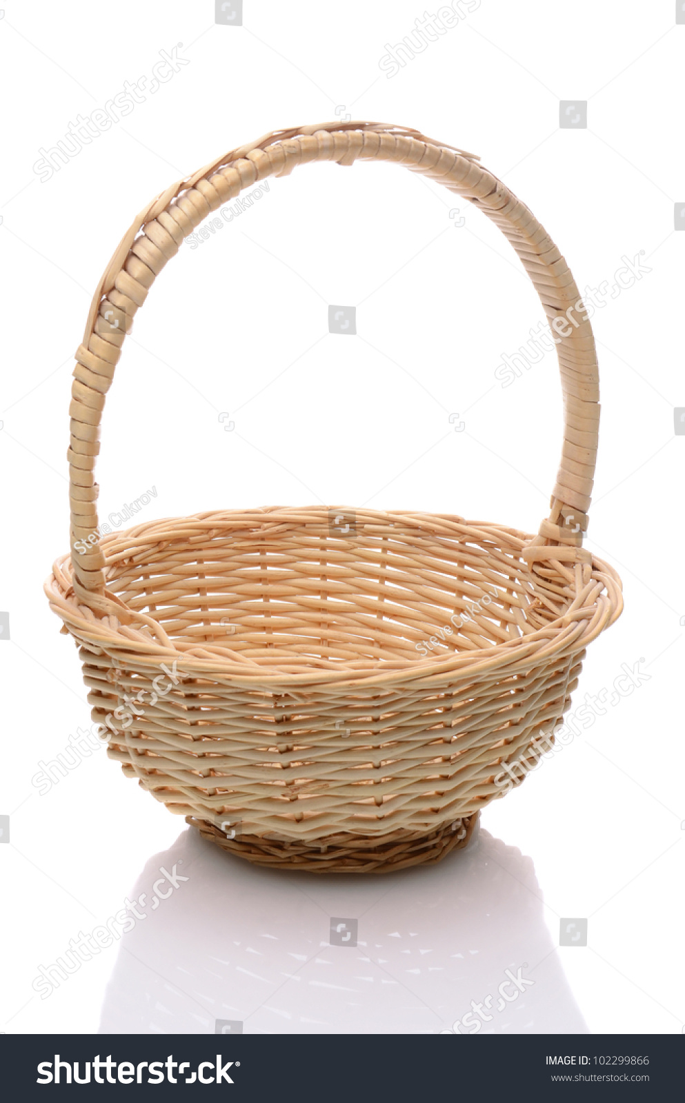 White wicker baskets with handle - Round Wicker Basket With Handle Isolated On A White Background With Slight Reflection