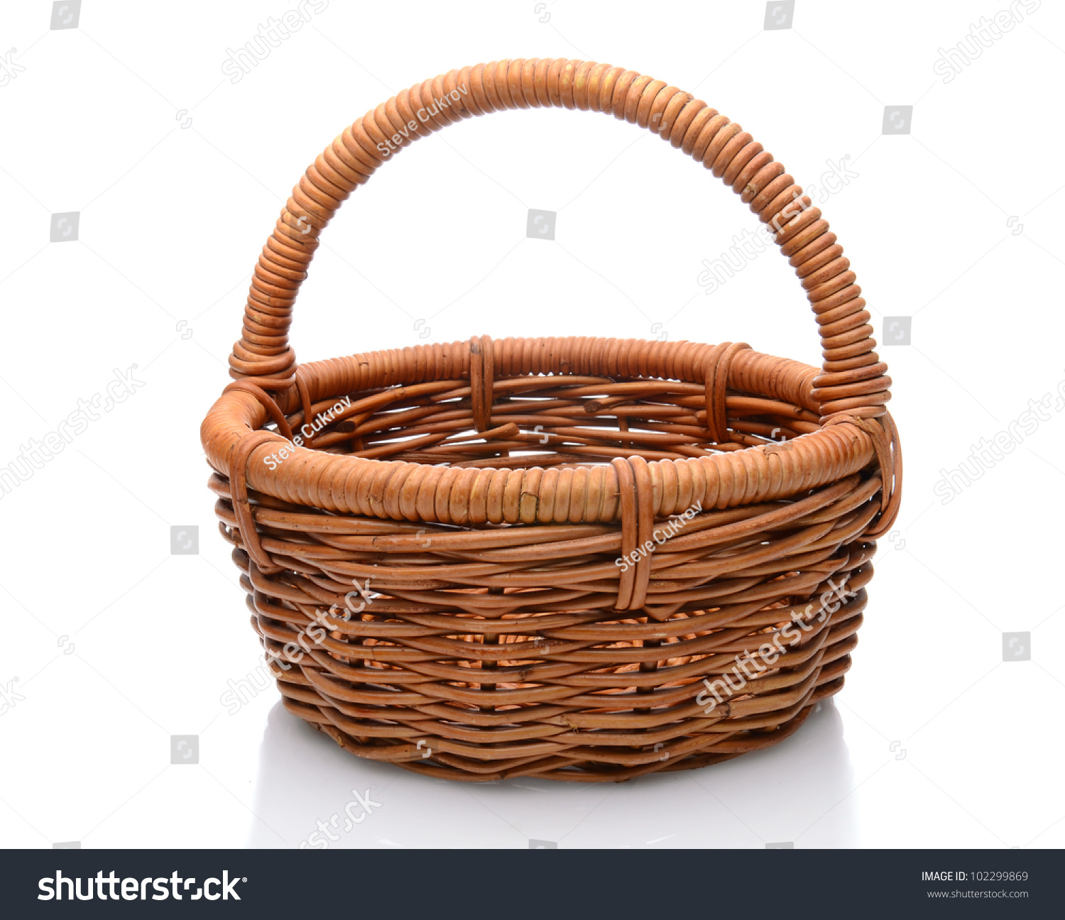 White wicker baskets with handle - Round Brown Wicker Basket With Handle Isolated On A White Background With Slight Reflection