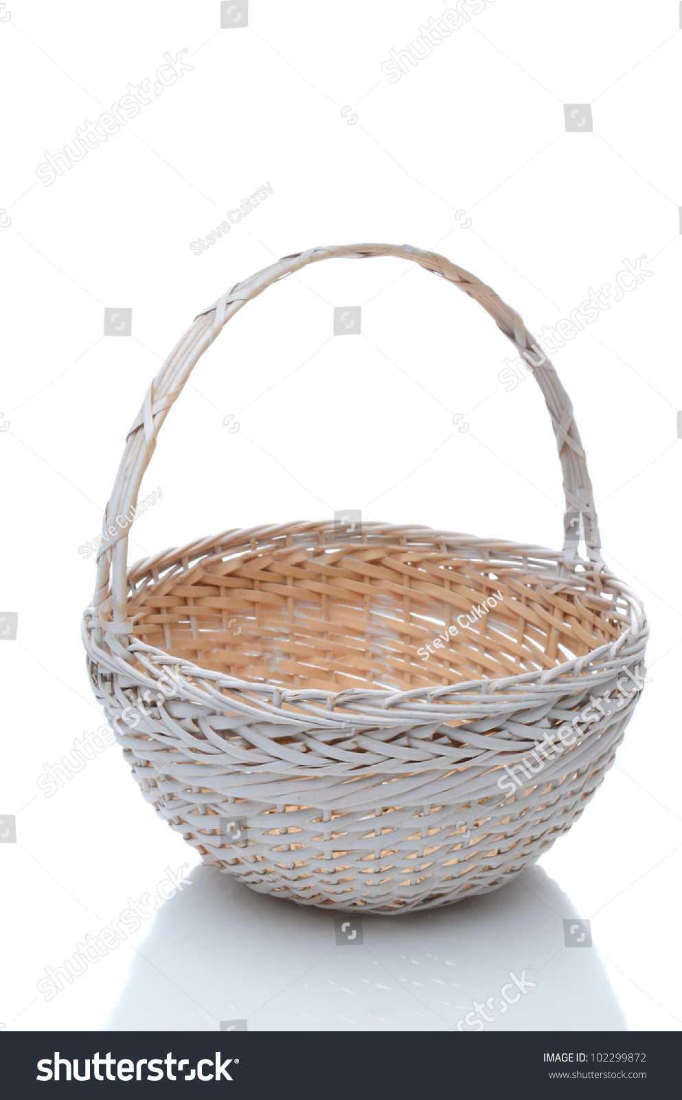 White wicker baskets with handle - Round White Wicker Basket With Handle Isolated On A White Background With Slight Reflection