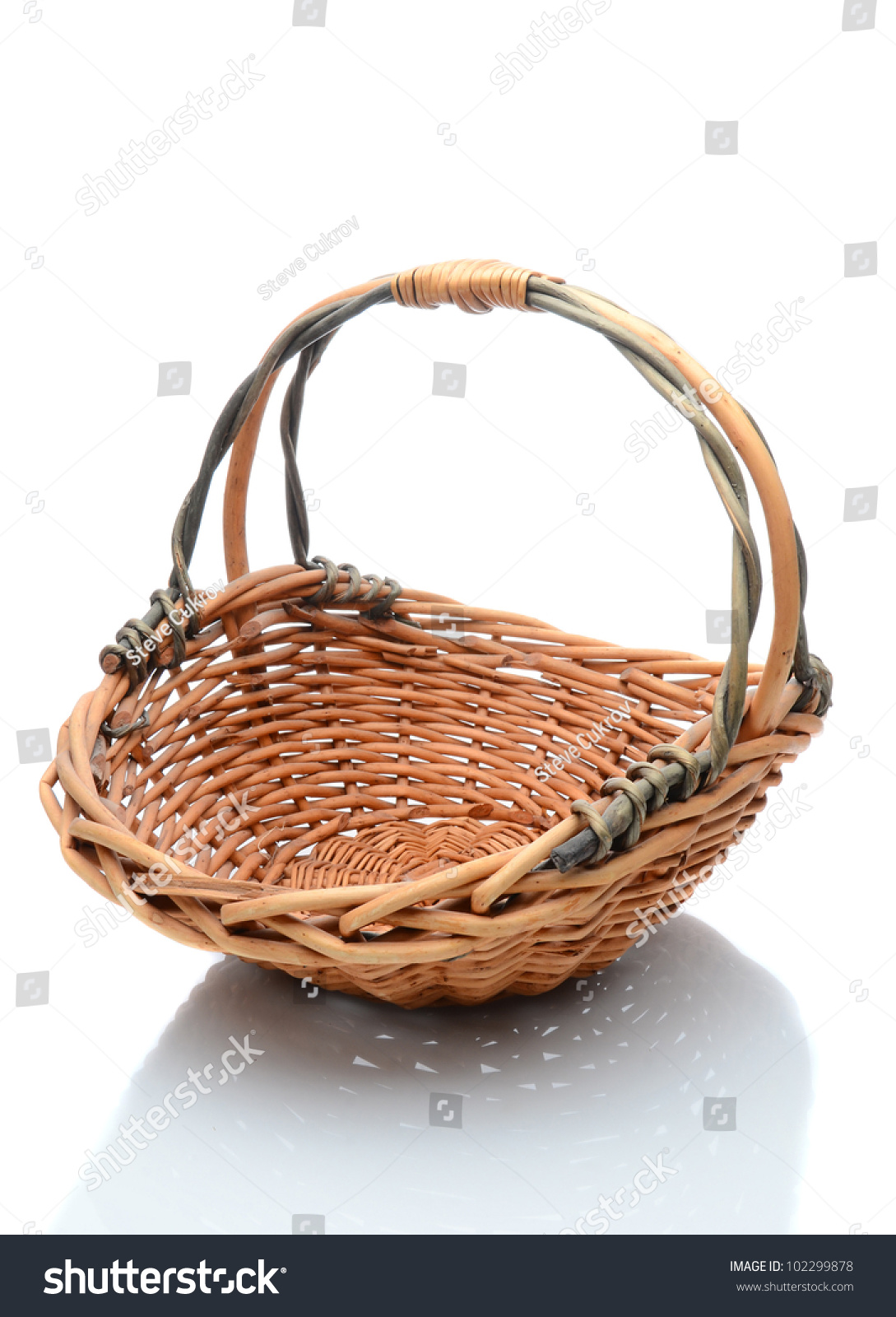 White wicker baskets with handle - Oval Wicker Flower Basket With Handle Isolated On A White Background With Slight Reflection