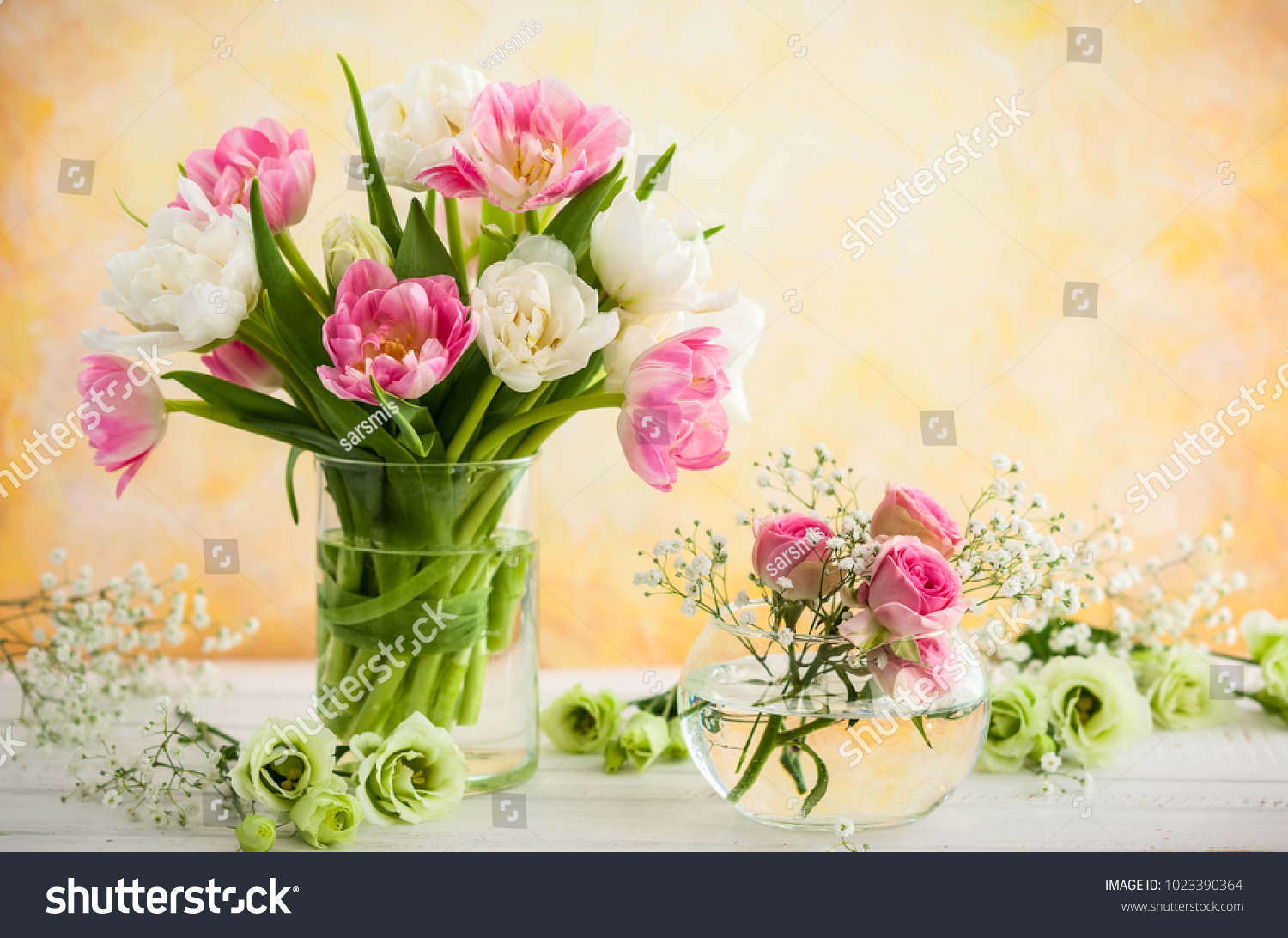 Beautiful flowers bouquet vase on wooden stock photo 1023390364 beautiful flowers bouquet in vase on the wooden tabletulipsroses and eustoma izmirmasajfo Image collections