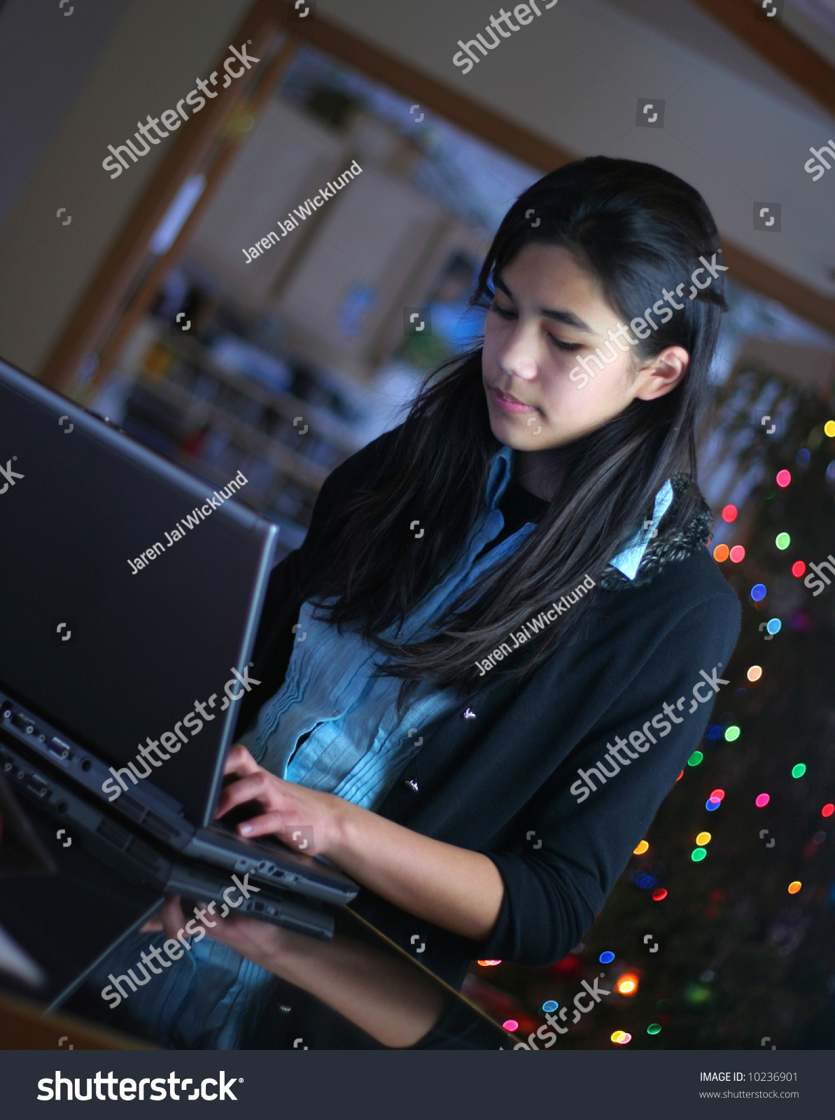 astralnymphets cute Filename:  stock-photo-teen-girl-working-on-laptop-christmas-tree-in-background-part-scandinavian-thai-descent-10236901.jpg