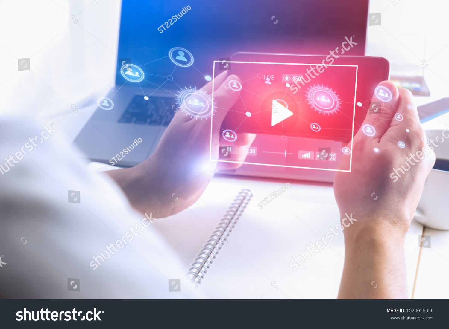Man hand using Smartphone to watch Live streaming media online technology.
