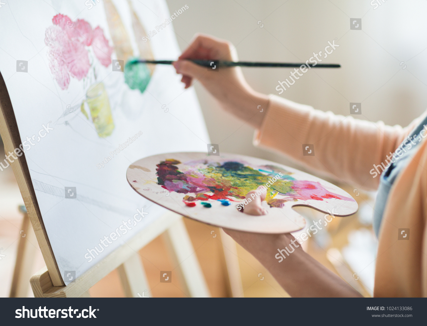 art, creativity and people concept - close up of artist with palette and brush painting still life on paper at studio #1024133086