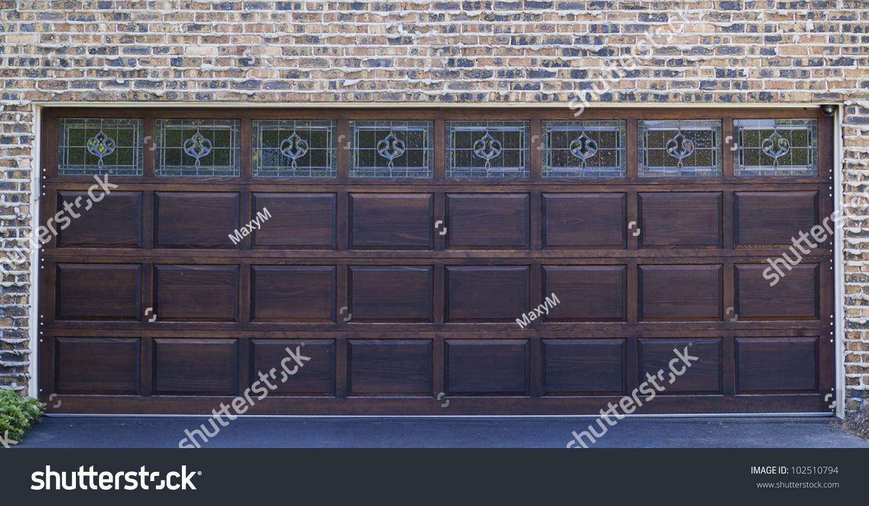 872 #414967 Dark Wooden Garage Door With Brick Wall Background Stock Photo  wallpaper Dark Wood Garage Doors 36951500