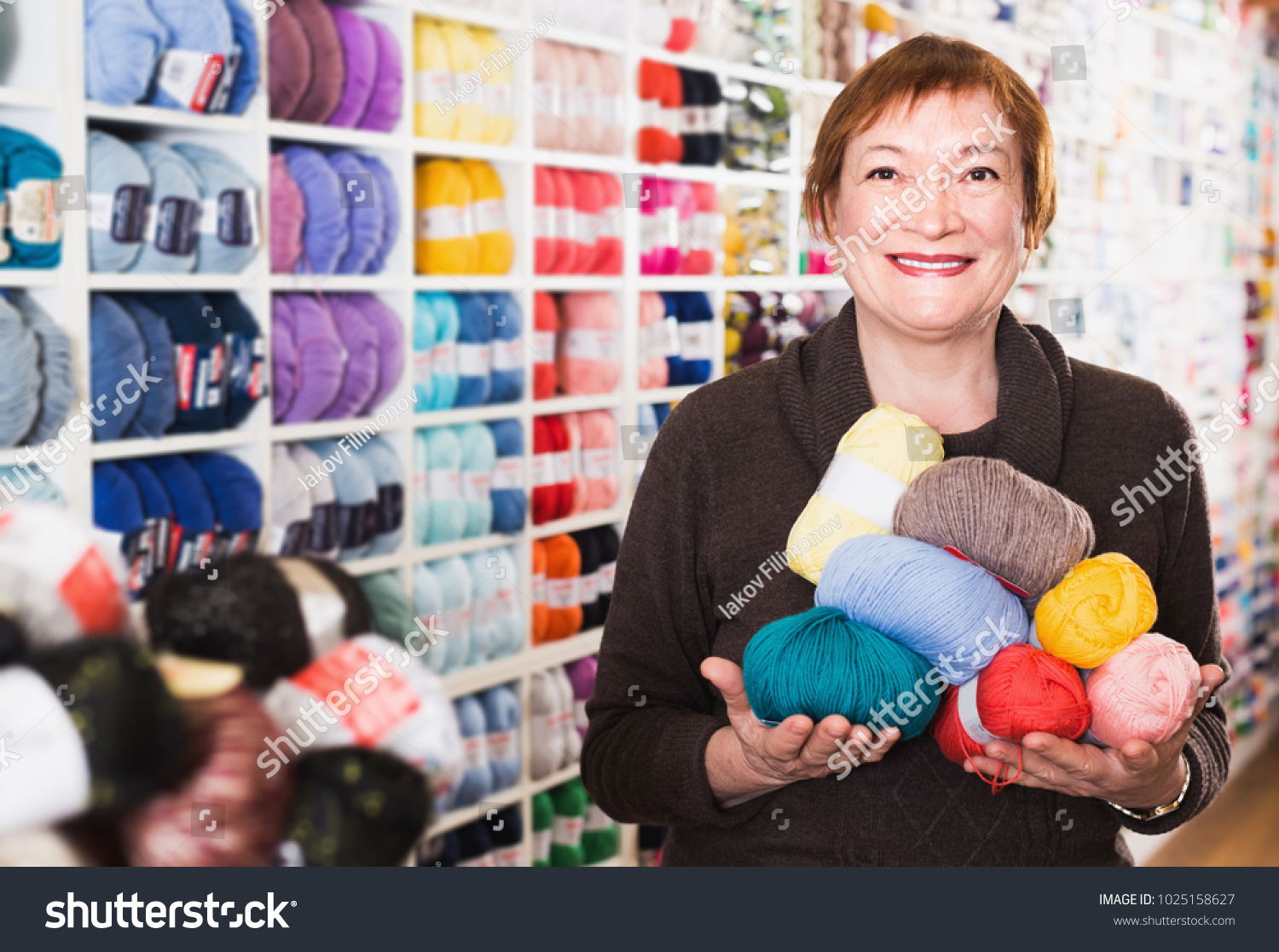 Portrait Smiling Mature Female During Shopping Stock Photo ...