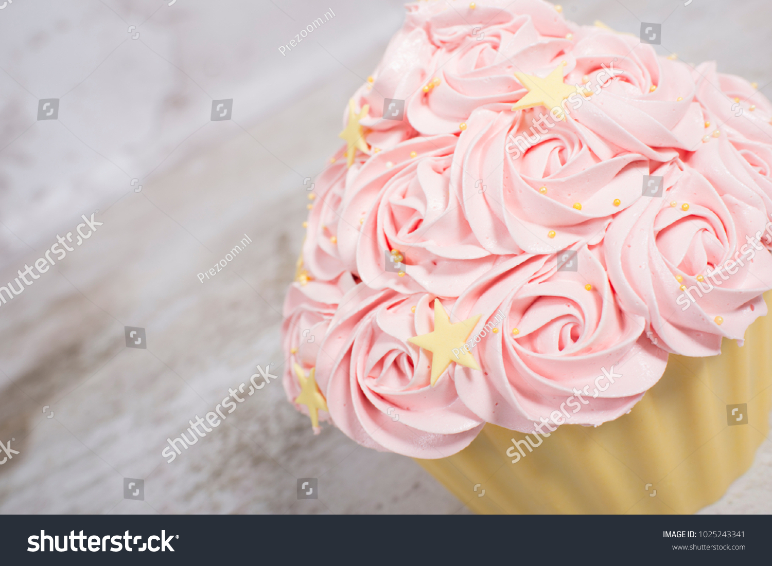 Gorgeous cupcake shaped birthday cake roses stock photo image gorgeous cupcake shaped birthday cake with roses as icing izmirmasajfo