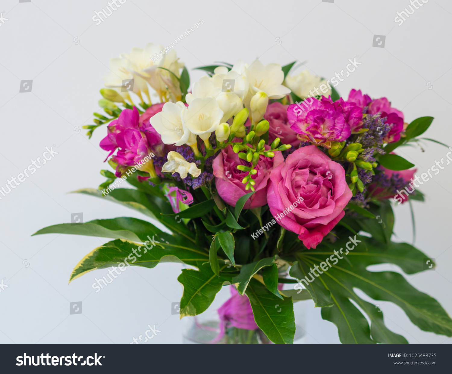 Close up pink rose and white freesia flower bouquet with green id 1025488735 izmirmasajfo
