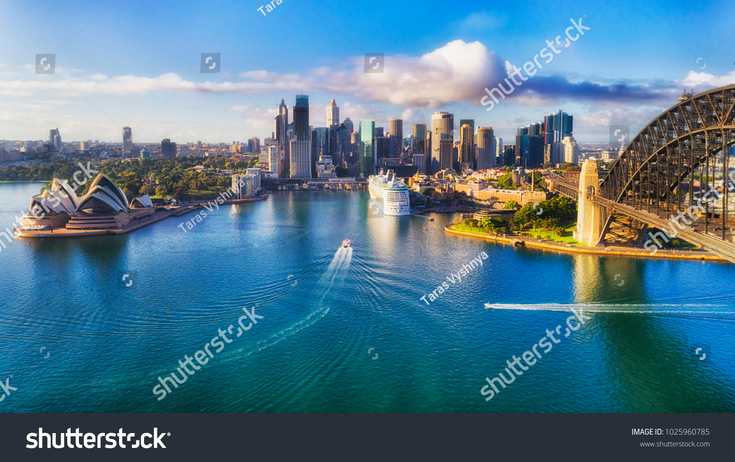 Major architecture landmarks of the city of Sydney and Australia around Sydney harbour in elevated aerial view in warm smooth sunlight at the morning. #1025960785