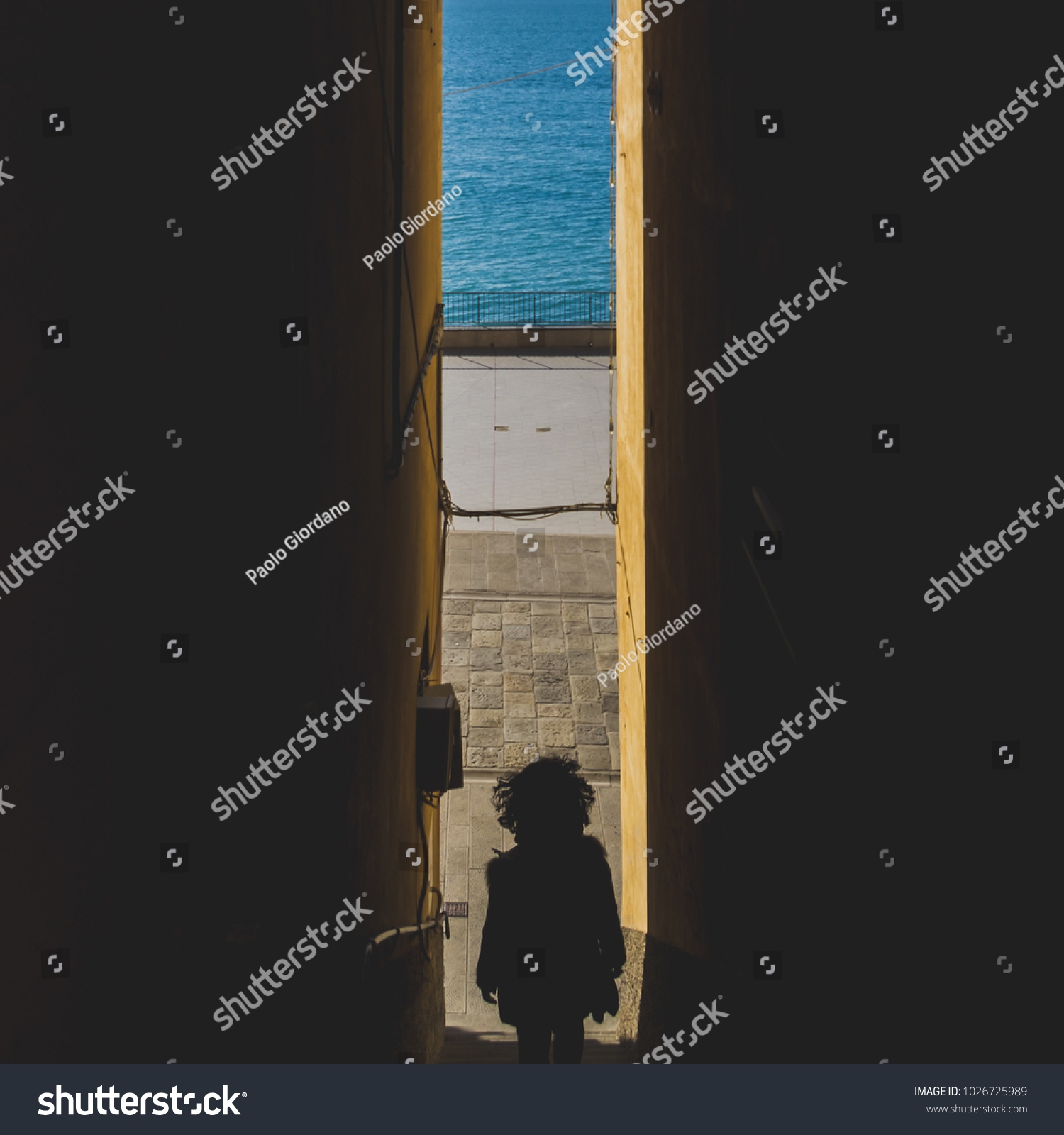 Rear View Woman Descending Staircase Between Stock Photo Edit Now