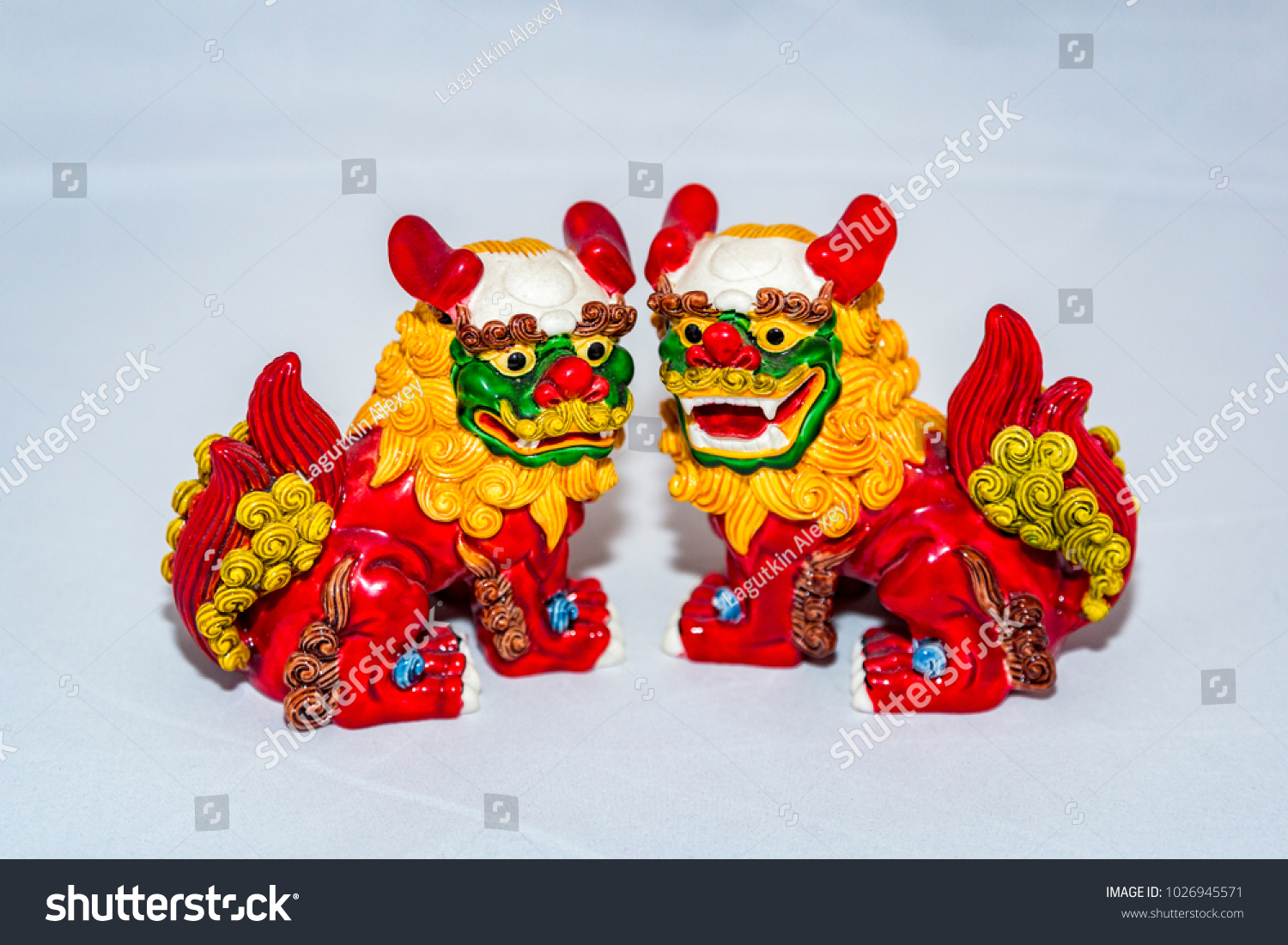 a small figure of a multi colored dragon of asian themes