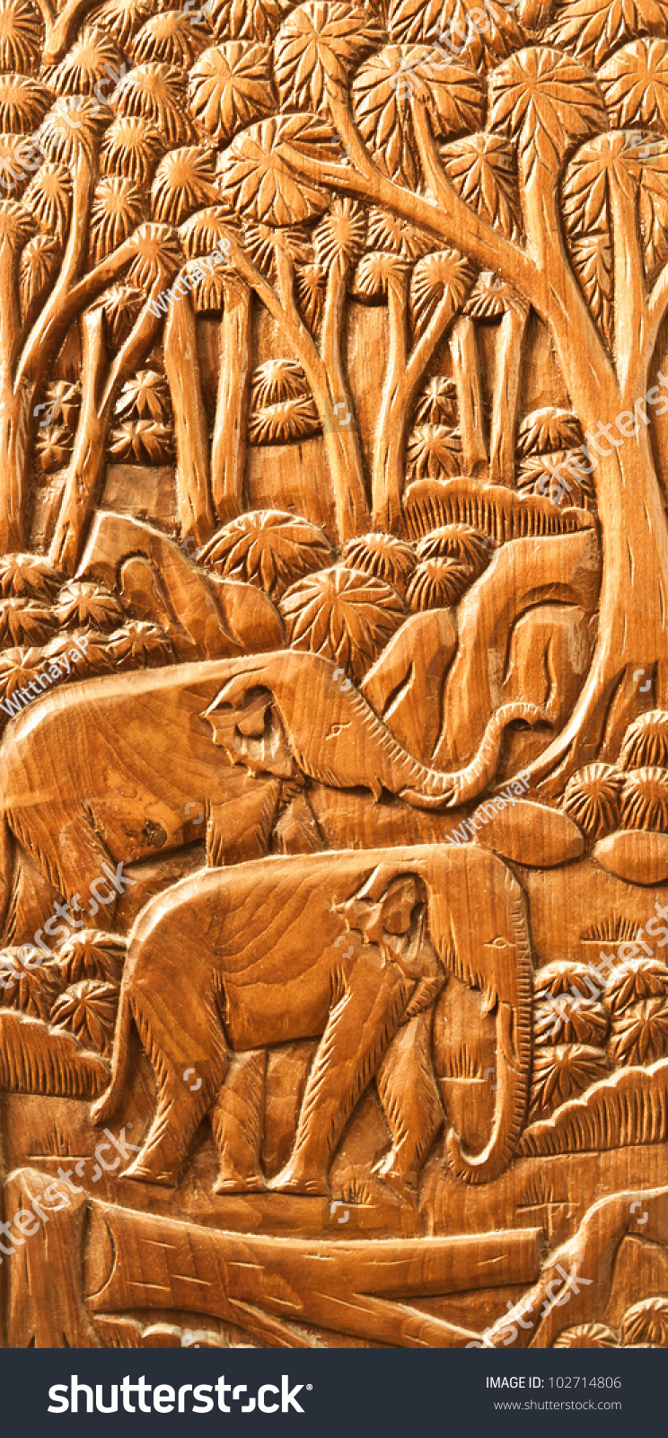 Carved thai elephant on the wood wall stock photo