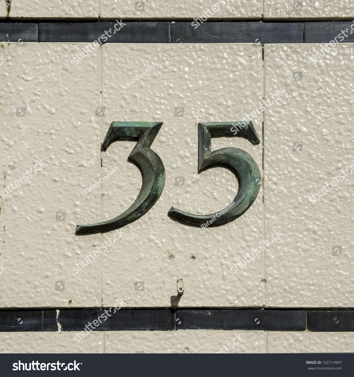Ceramic address tiles gallery tile flooring design ideas bronze house number thirtyfive on wall stock photo 102714947 bronze house number thirty five on a dailygadgetfo Choice Image