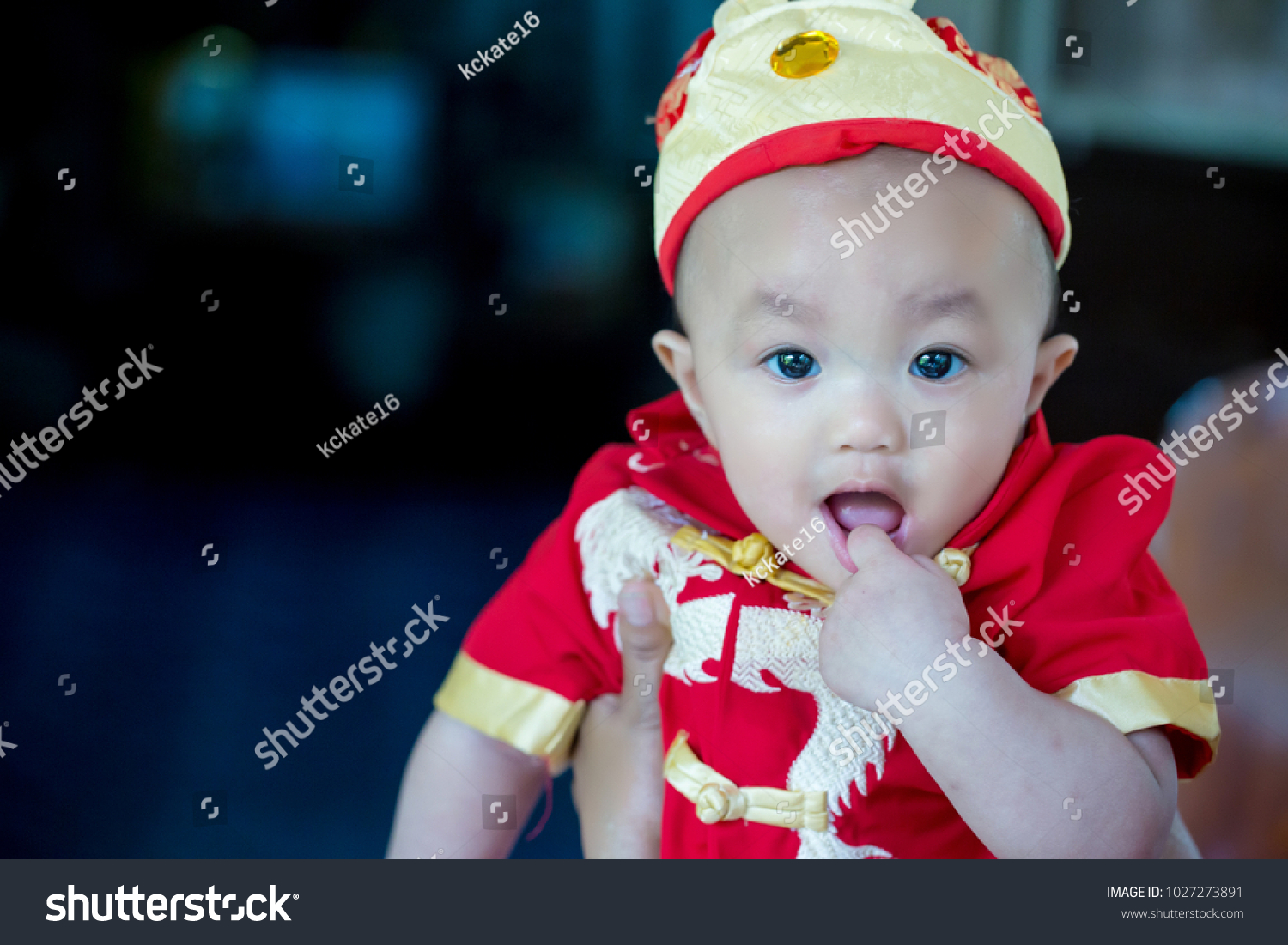573b85a2a Focus cute baby boy wear red and gold chinese suit on chinese new year day.