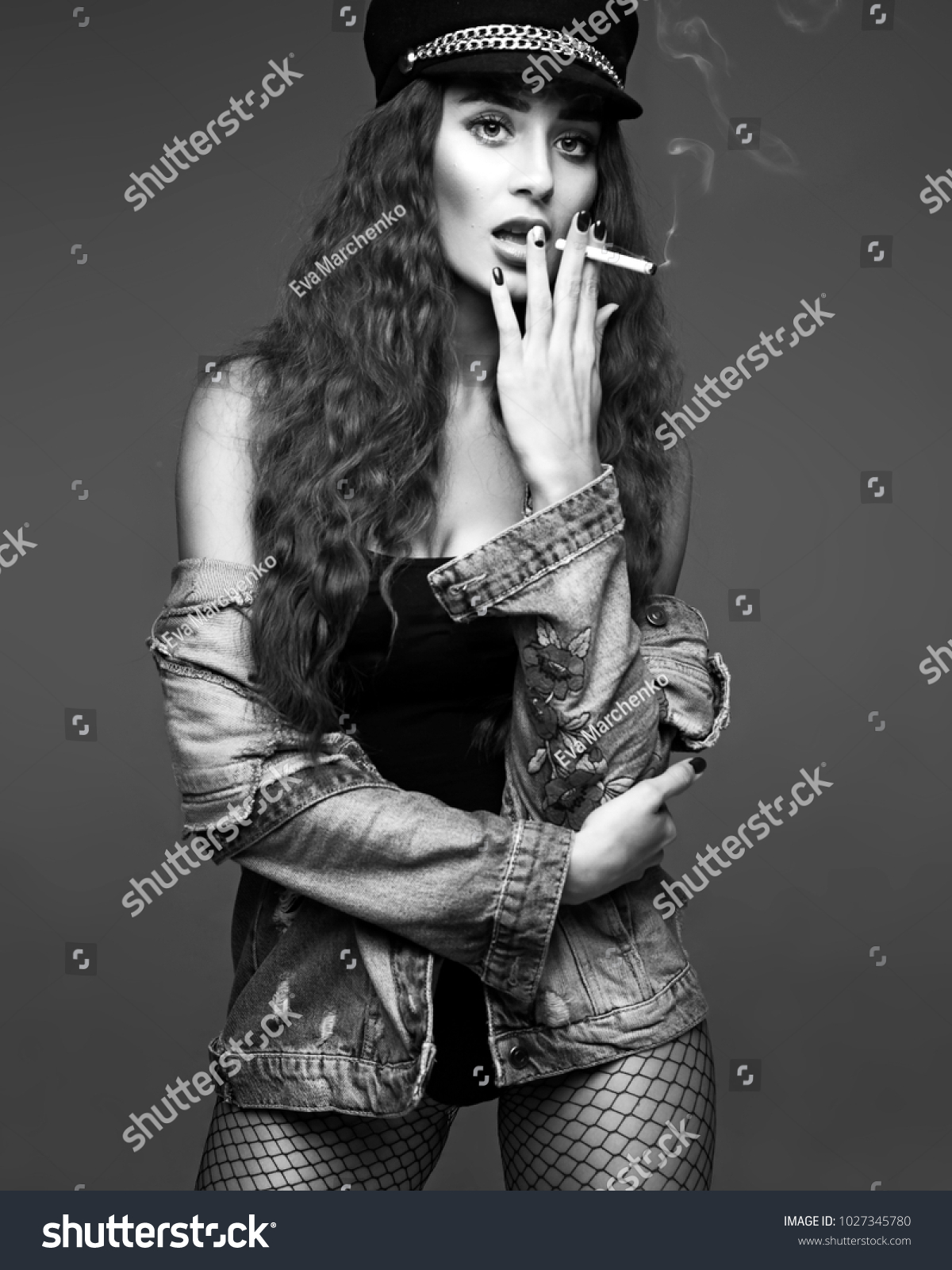 d5c79ea8f5 Black and white studio portrait of young pretty sexy woman with long  brunette curly hair in