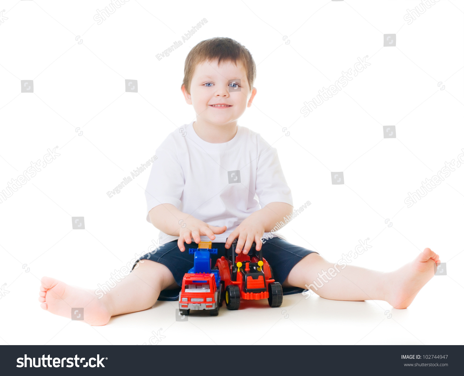 Little Boy With Toy Car : Smiling little boy playing with toy cars stock photo