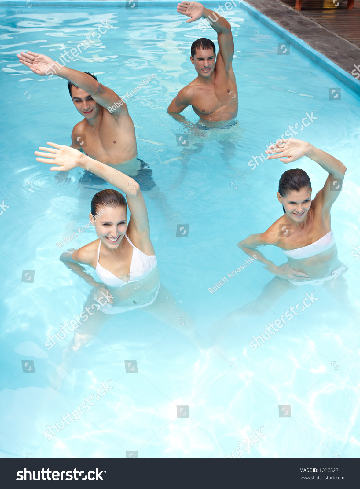 Happy Group Doing Aqua Fitness In Swimming Pool Stock
