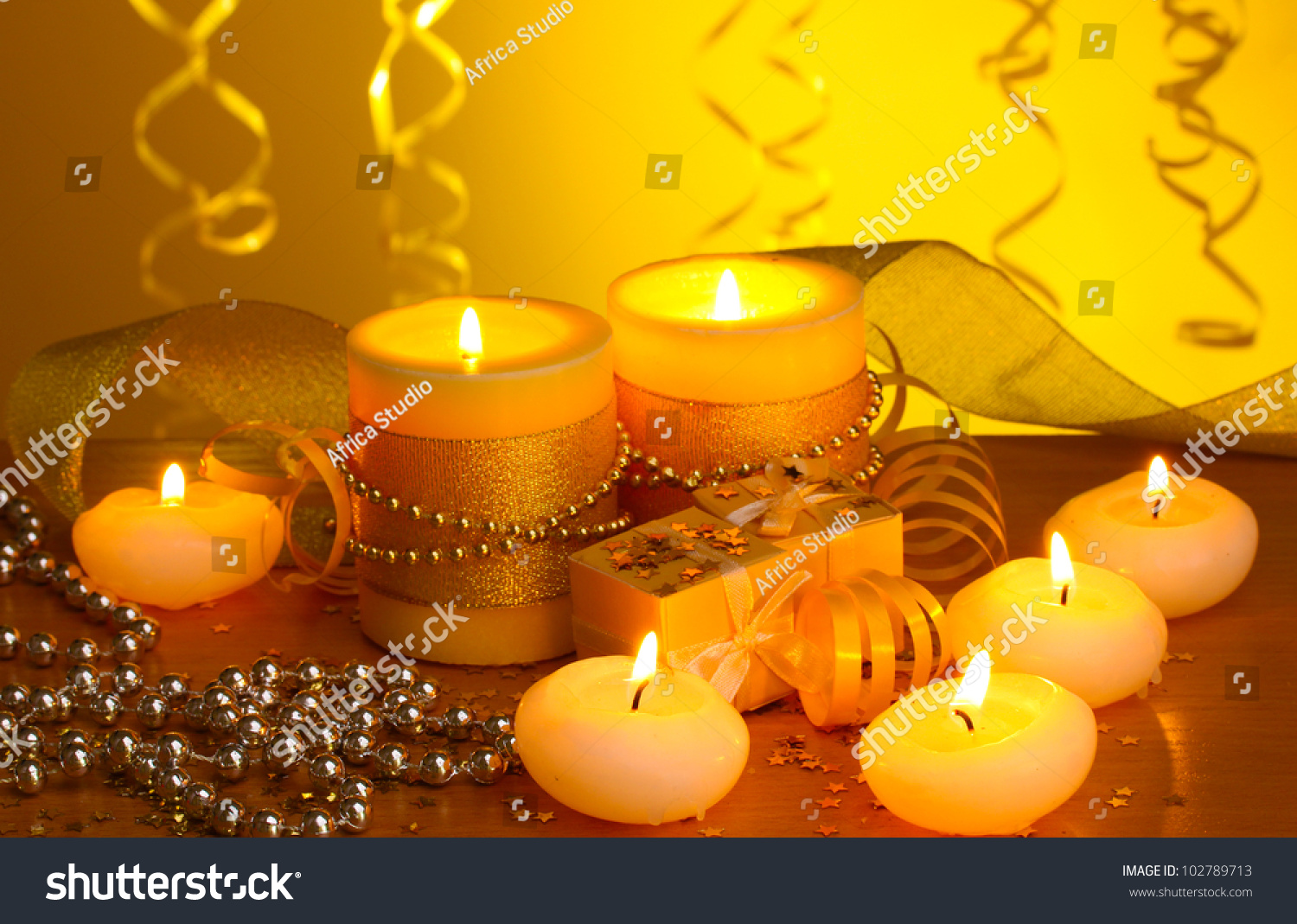 Beautiful Candles, Gifts And Decor On Wooden Table On