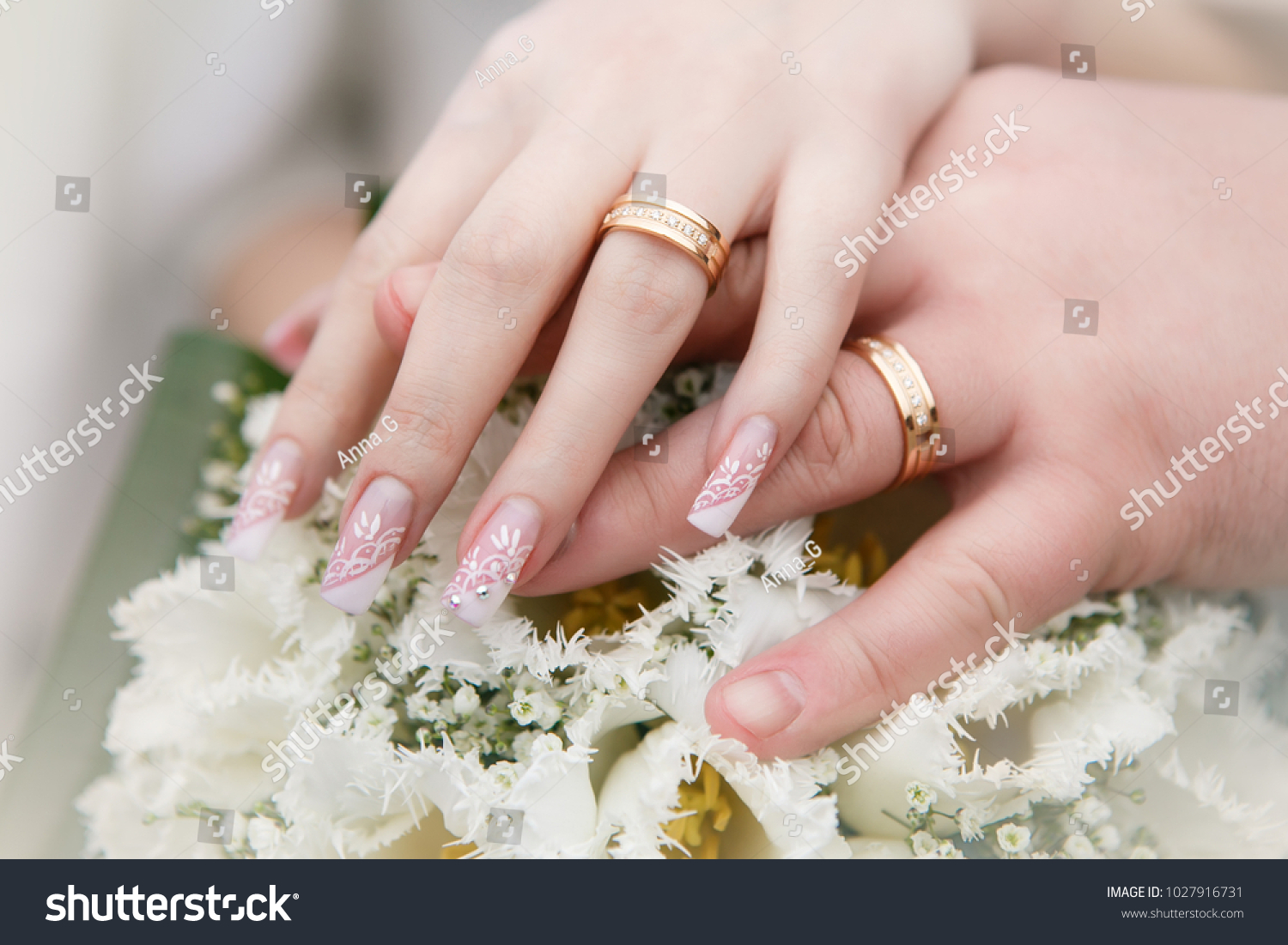 Bouquet of white tulips, hands of groom and bride with gold wedding ...