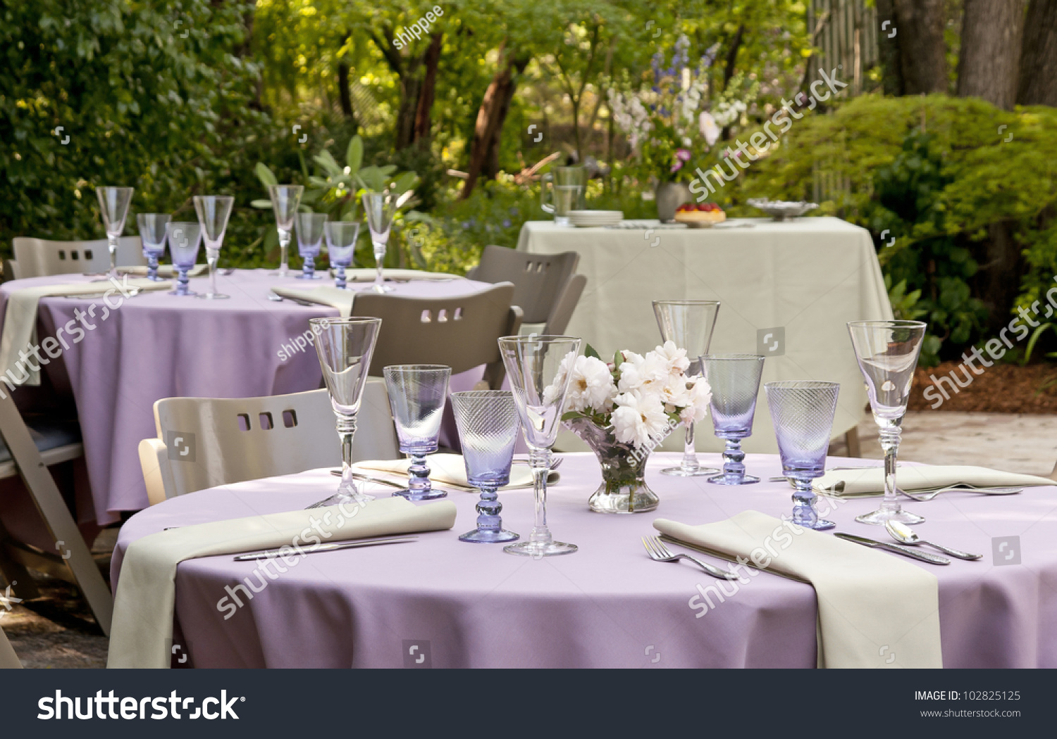 Garden Set Up For A Outdoor Party Tables With Dessert Table In The Background