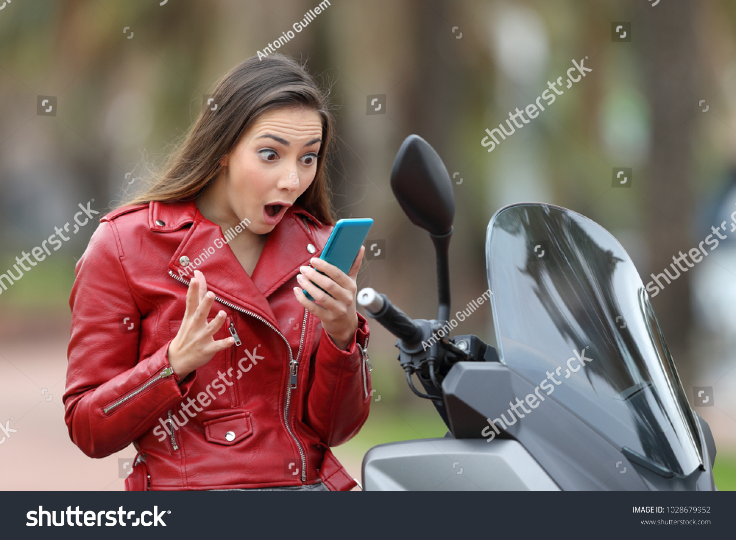 stock-photo-amazed-motorbiker-reading-ex