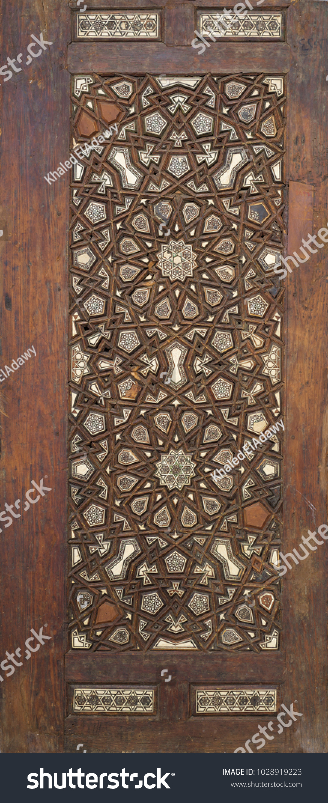 Ottoman style wooden ornate door leaf tongue and groove assembled inlaid with ivory, ebony and bone, Cairo, Egypt #1028919223