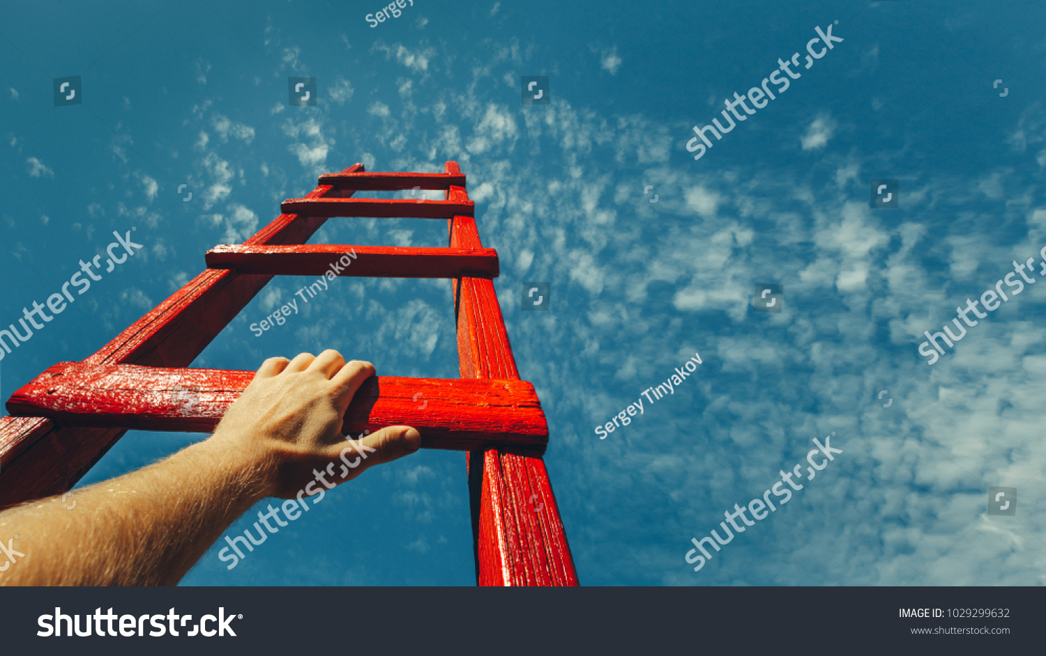 Development Attainment Motivation Career Growth Concept. Mans Hand Reaching For Red Ladder Leading To A Blue Sky #1029299632