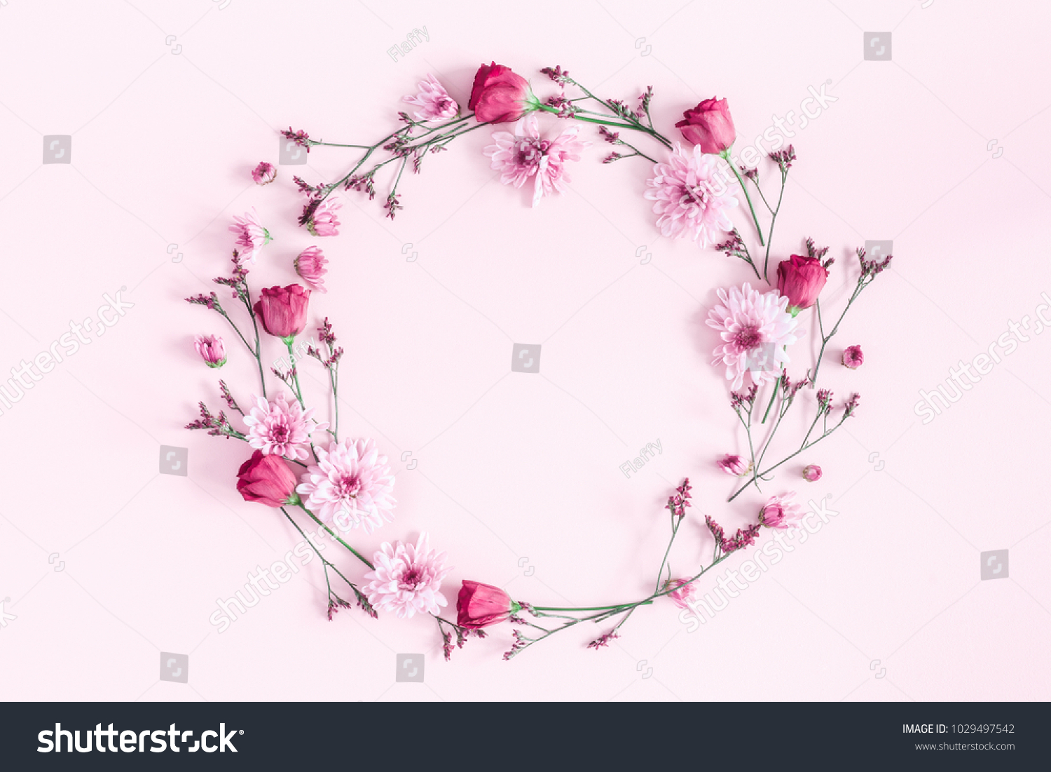 Flowers composition. Wreath made of pink flowers on pink background. Flat lay, top view, copy space #1029497542
