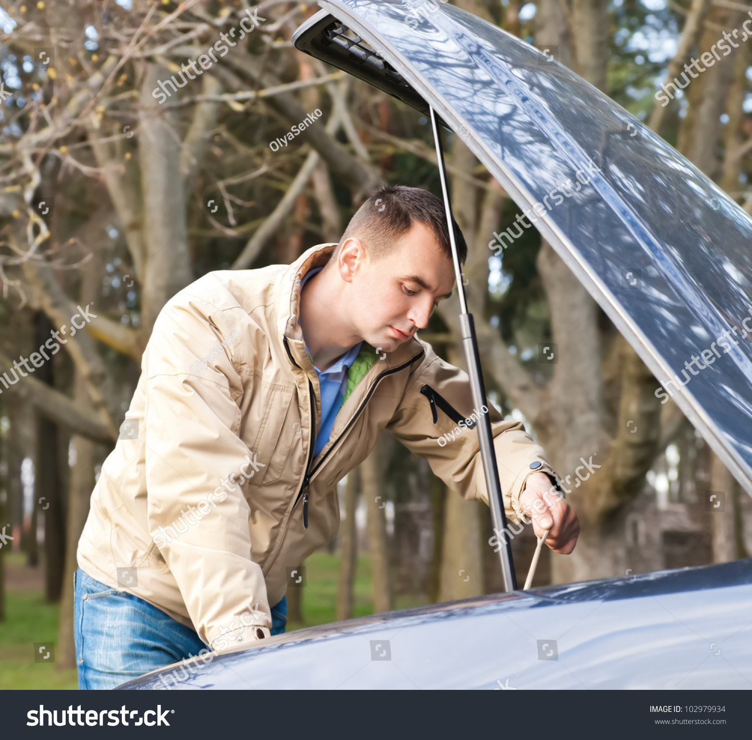 Man Looking Under The Hood Of A Car Stock Photo 102979934