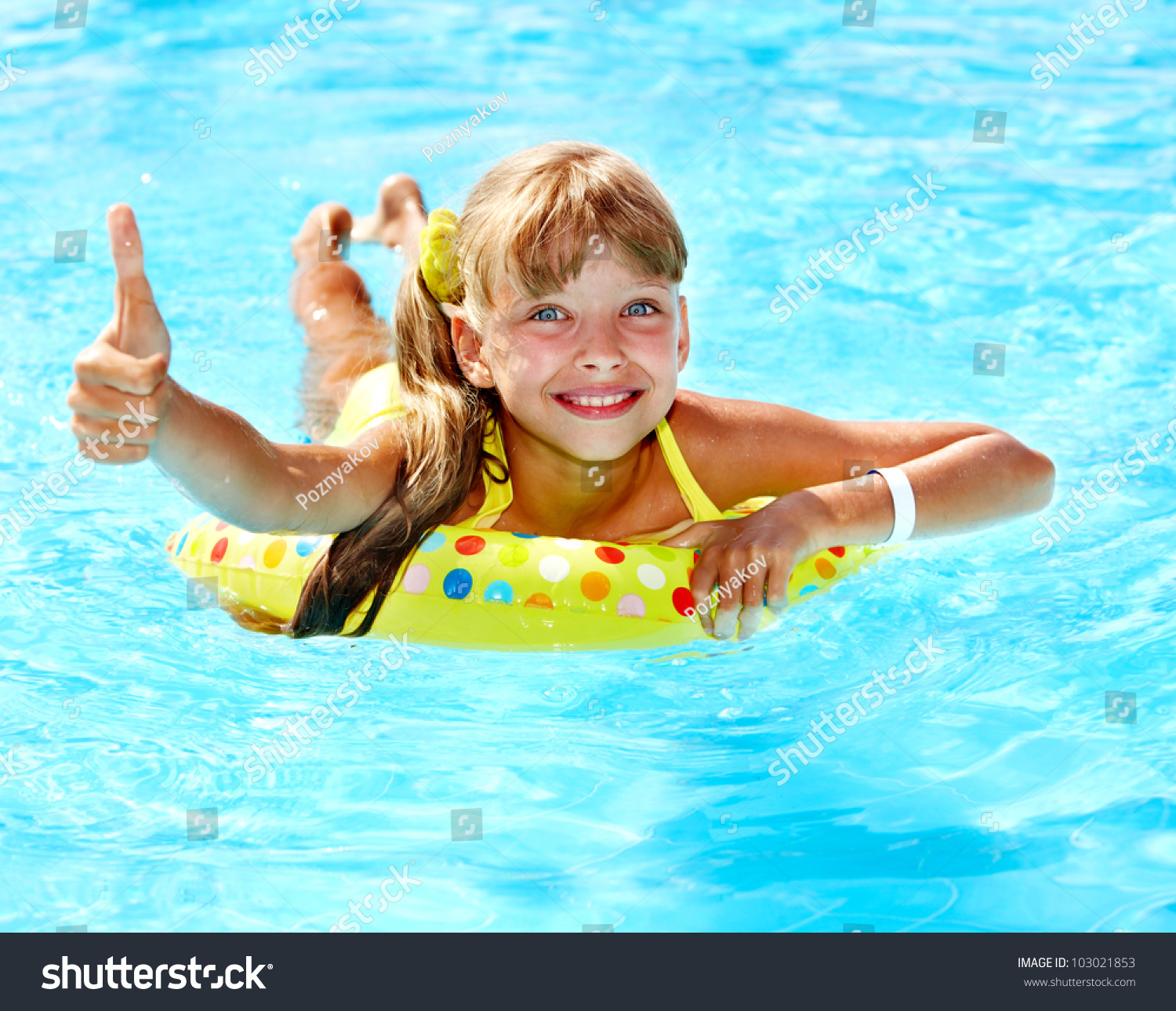 Children Sitting On Inflatable Ring In Swimming Pool Stock Photo 103021853 Shutterstock