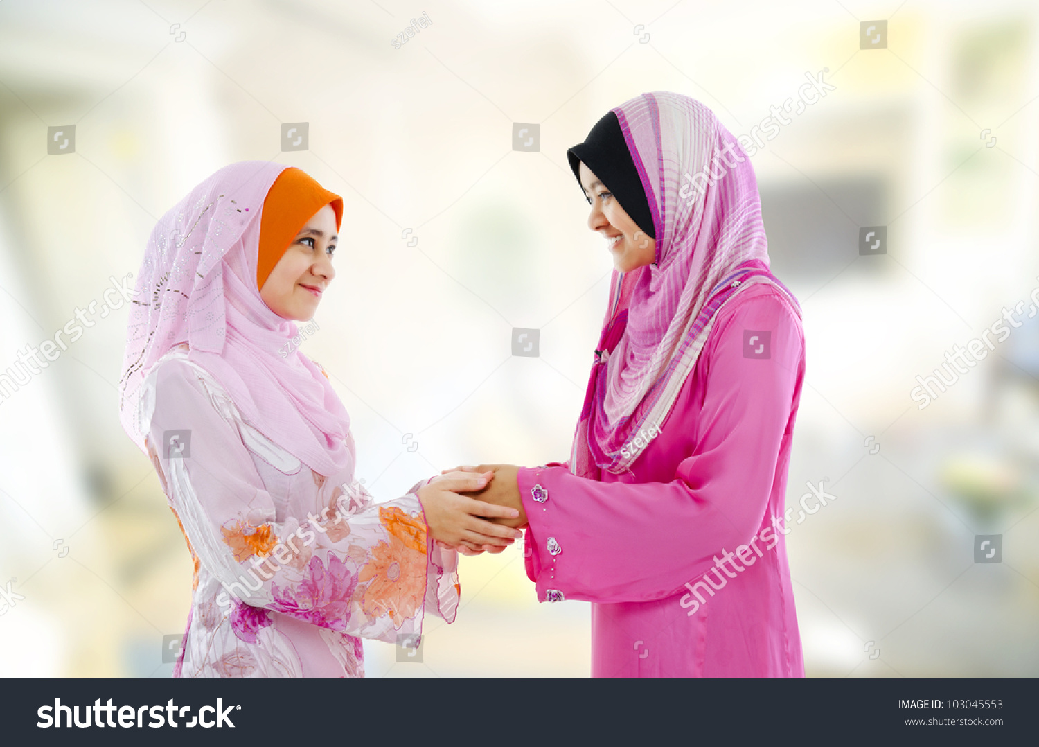 Muslim woman traditional clothing greeting each stock photo image muslim woman in traditional clothing greeting to each other indoor m4hsunfo