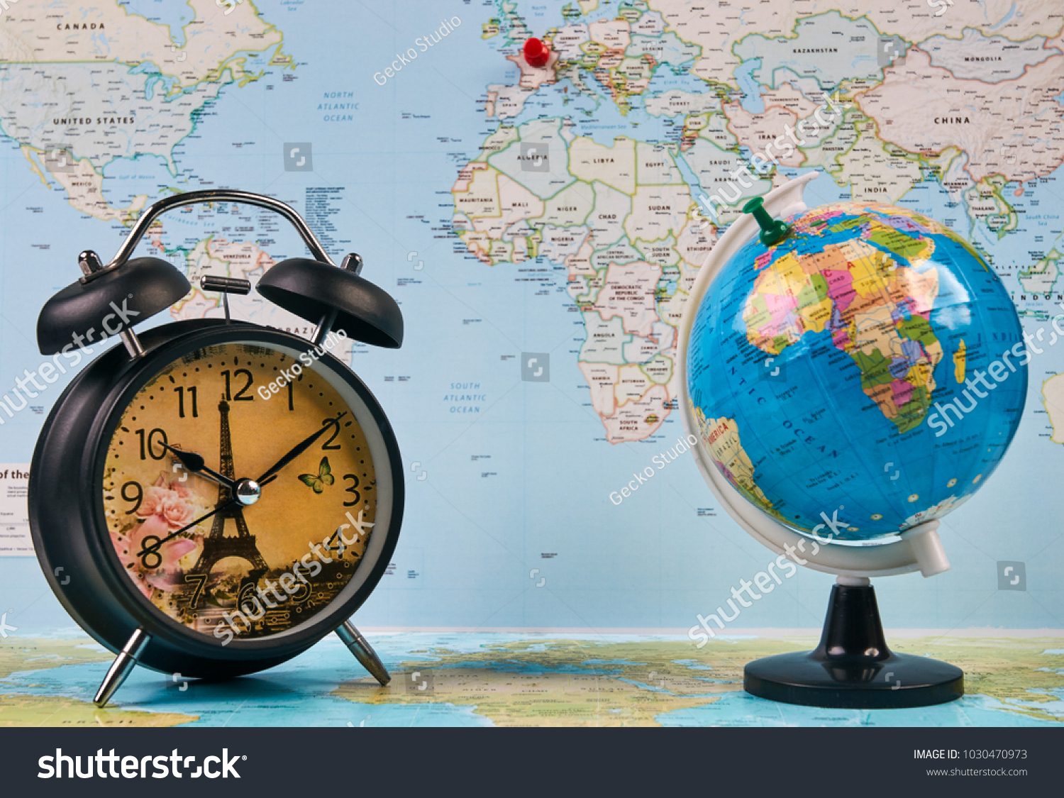Planing travel france paris worldmap globe stock photo royalty free planing for travel to france paris with worldmap globe and alarm clock travel time in gumiabroncs Image collections