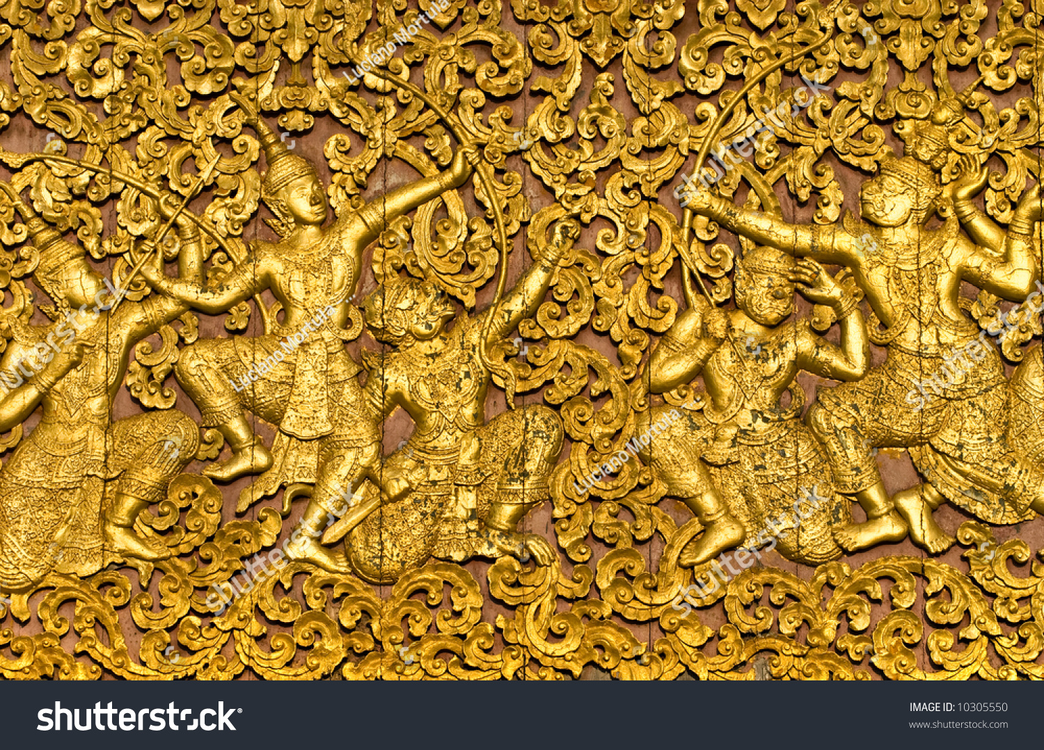 The ramayana epic carved on a wood door inside a temple Luang Prabang Laos