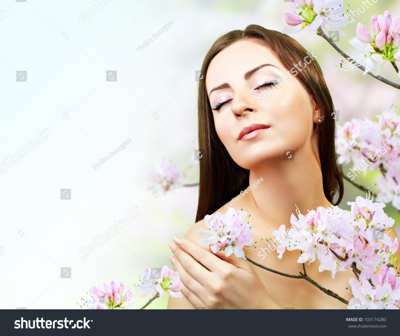 Spring Skin Care: Beautiful Girl Spring Flowers Skin Care Stock Photo